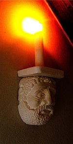 Hand carved wall candle-holdera
